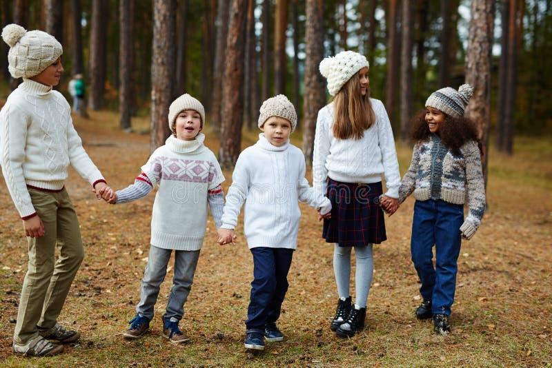 Children Enjoying Walk in Autumn Forest stock image
