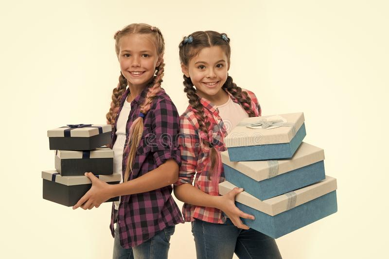 Children excited about unpacking gifts. Small girls sisters received birthday gifts. Dreams come true. Best birthday and. Christmas gifts. Kids little girls stock images