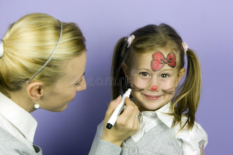 Children face painting royalty free stock photos