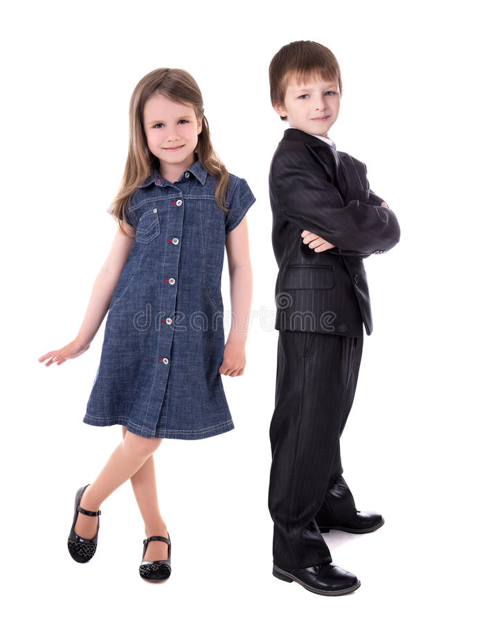 Children fashion concept - little boy in business suit and girl stock photo