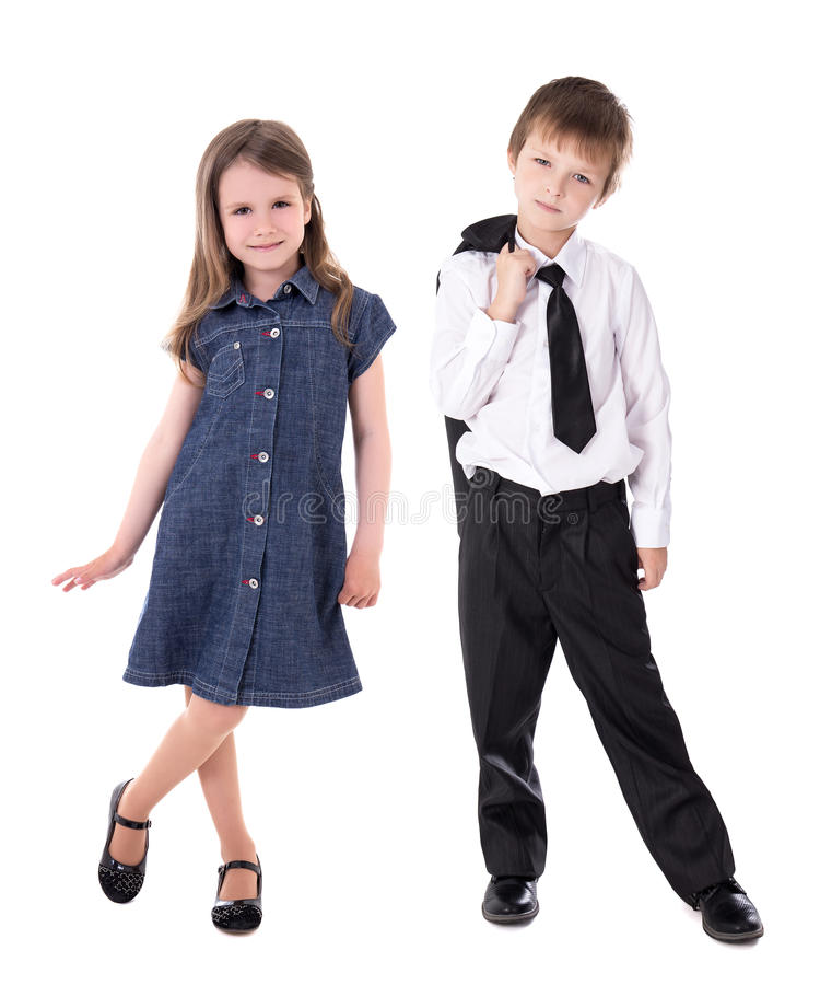 Children fashion concept - little boy in business suit and girl stock photography