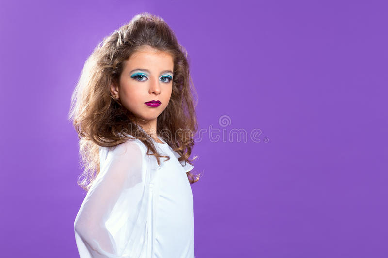 Children fashion makeup kid girl on purple royalty free stock photos
