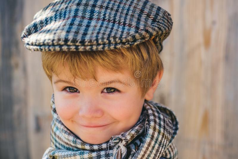 Children fashion model. Cute child. Boy in the cap. Vintage kid concept. Nice baby smile. Kids face. stock photography