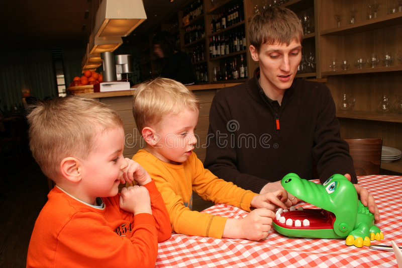 Children With Father In Cafe Royalty Free Stock Images