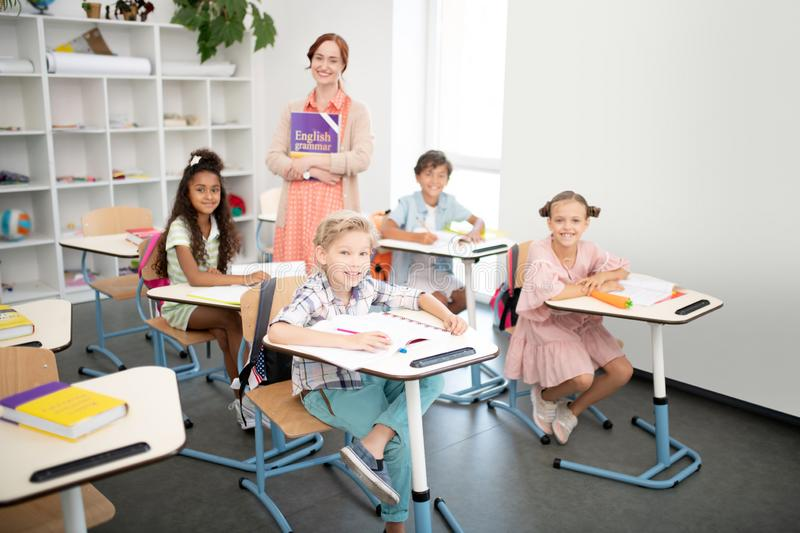 Children feeling excited before having first English class royalty free stock photo