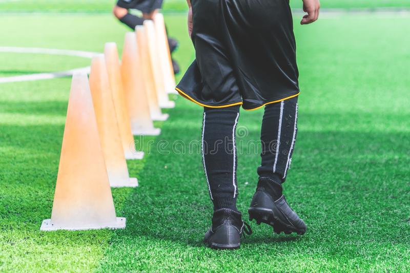 Children feet with soccer training on training cone on soccer ground stock photo