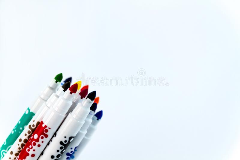 Children felt pens in 12 colors. Isolated on white stock photos