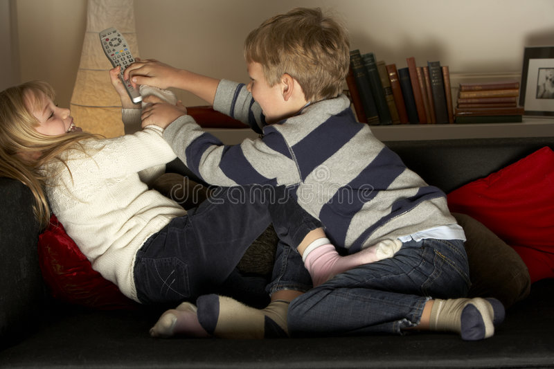 Children Fighting Over Remote Control royalty free stock photos
