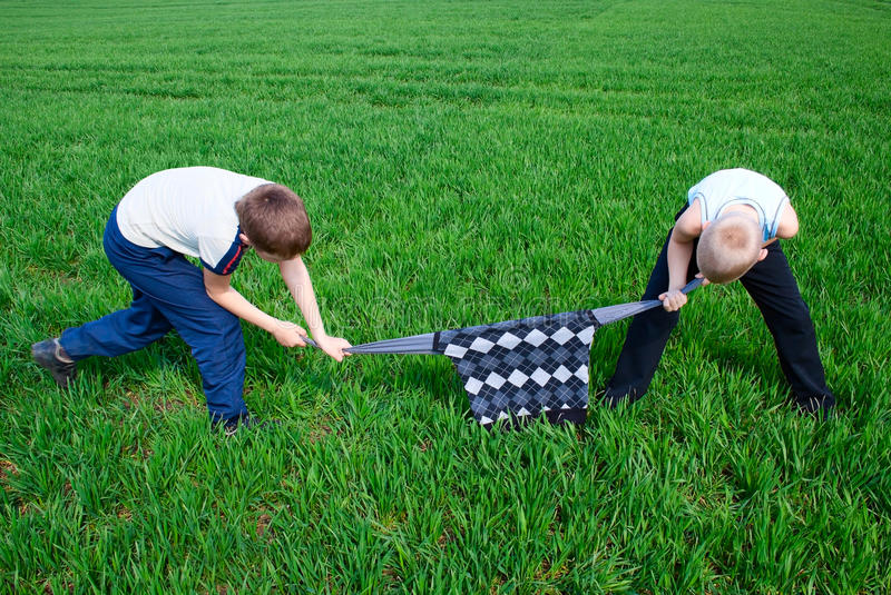 Download Children Fighting Over A Sweater Stock Photo - Image of field, fight: 24447424
