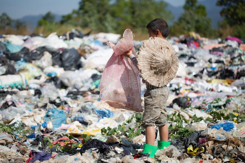 Children find junk for sale and recycle them in landfills, the lives and lifestyles of the poor, Child labor, Poverty and. Environment Concepts stock photography