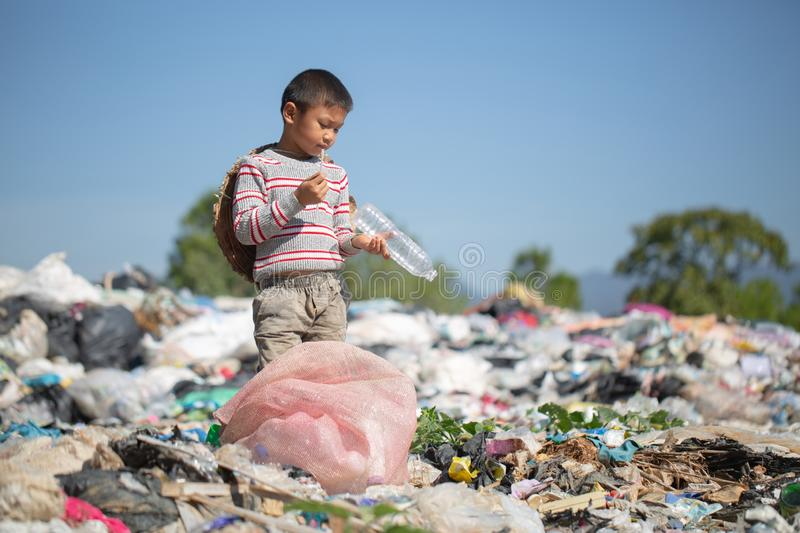 Children find junk for sale and recycle them in landfills, the lives and lifestyles of the poor, Poverty and Environment Concepts. Children find junk for sale stock photo