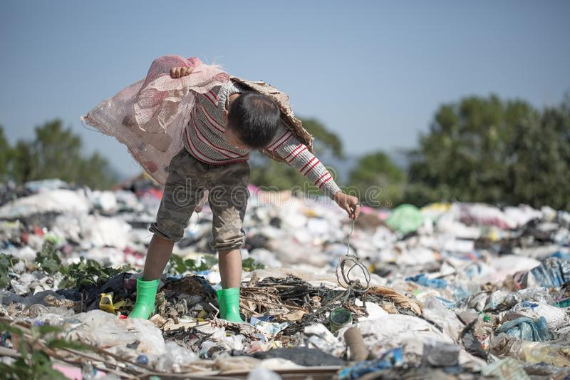 Children find junk for sale and recycle them in landfills, the lives and lifestyles of the poor, Poverty and Environment Concepts. Children find junk for sale stock images