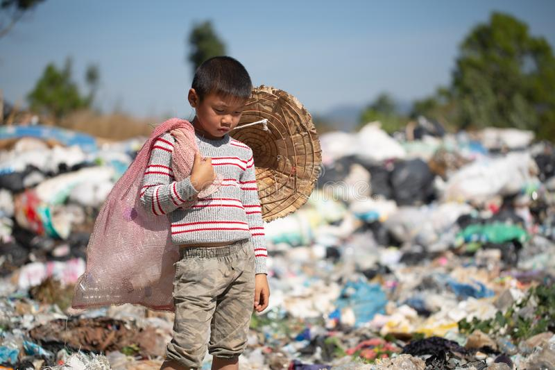Children find junk for sale and recycle them in landfills, the lives and lifestyles of the poor, Poverty and Environment Concepts. Children find junk for sale royalty free stock image