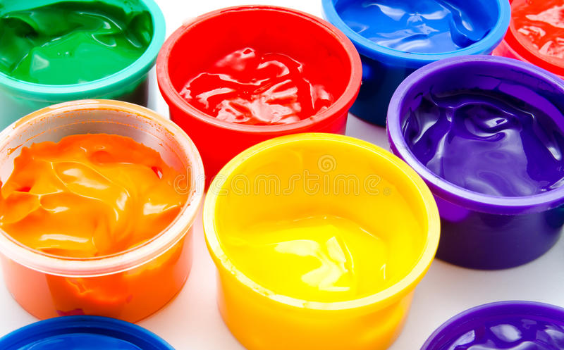 Children finger paint in paintbox royalty free stock photography