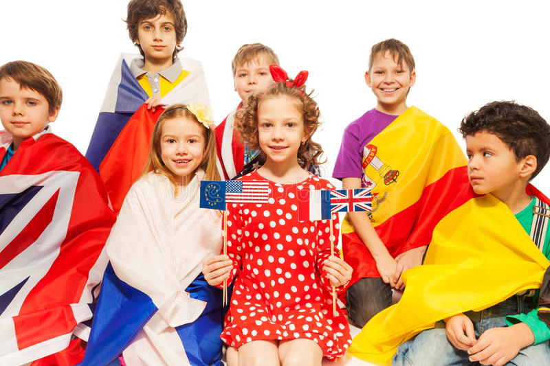 Children with flags wrapped in different banners royalty free stock image