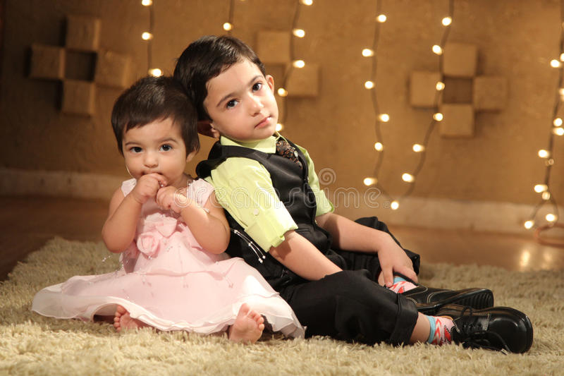 Children on the floor stock photography
