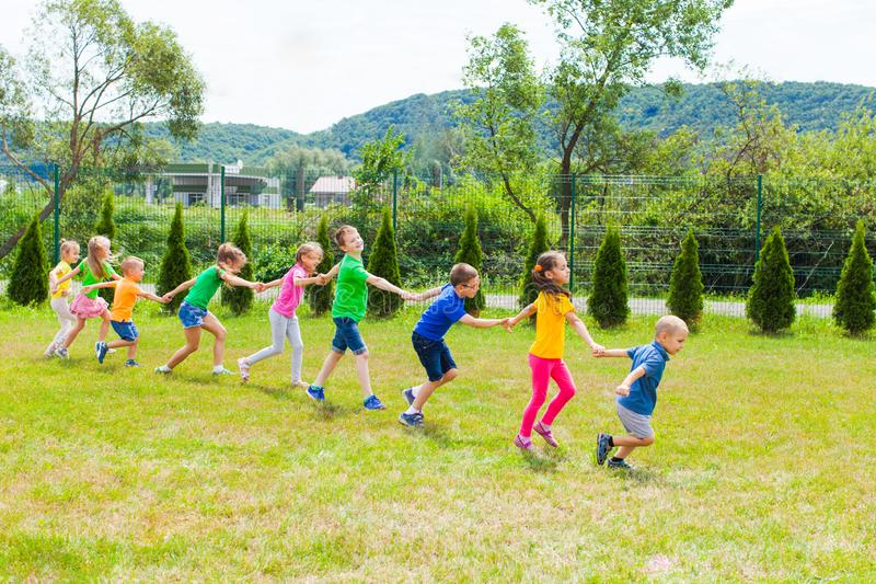 Children follow to each others and run together stock photos