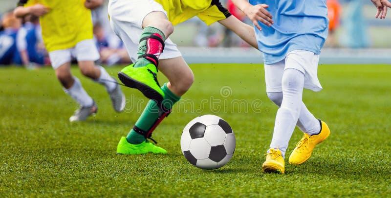 Children Football Players Running After the Ball. Kids Sport Duel. Running Youth Soccer Football Players. Boys Kicking Soccer Match stock photo