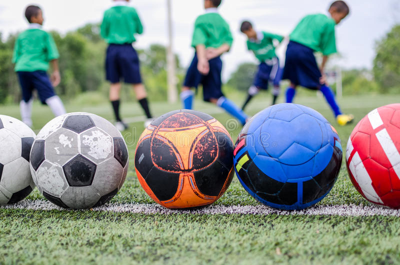 Children in football practice training stock images