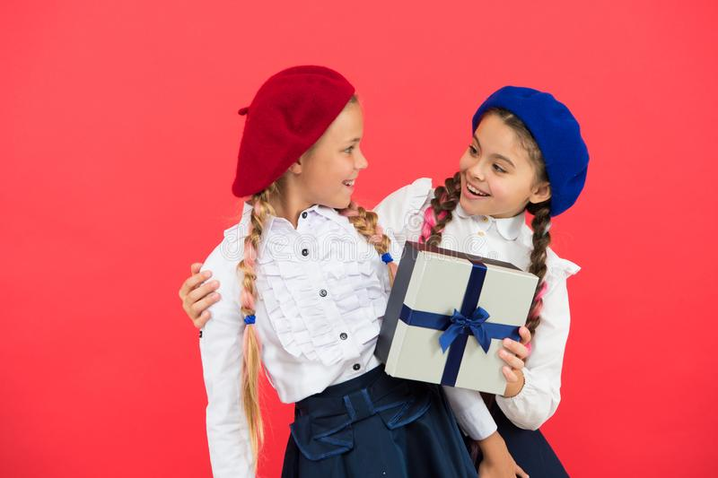 Children formal wear with gift box. Open gift now. Friendship concept. Birthday present. Shopping and holidays. For my. Dear friend. Girl giving gift box to royalty free stock photography
