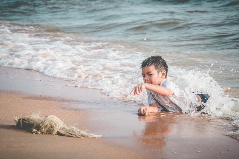 Children found a fishing net on the beach for enviromental clean up concept. Children found a junk fishing net on the beach for enviromental clean up concept stock photos