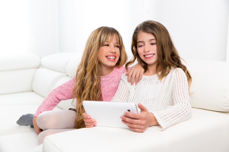 Children friends kid girls playing together with tablet pc stock images