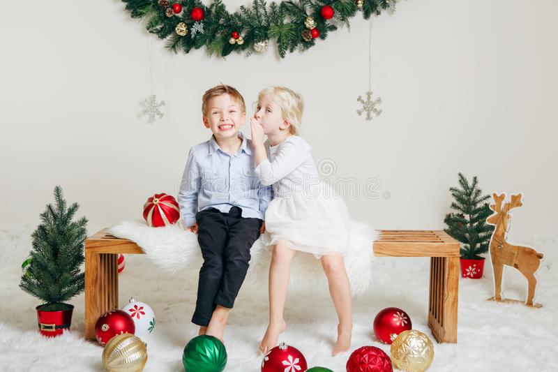 Children friends sitting together hugging kissing celebrating Christmas or New Year stock image