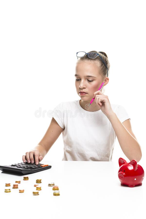 Children Frugal Concepts. Blond Teenage Girl Posing With Coins and Moneybox. Calculating Income With Calculator For Savings. Vertical Image stock image