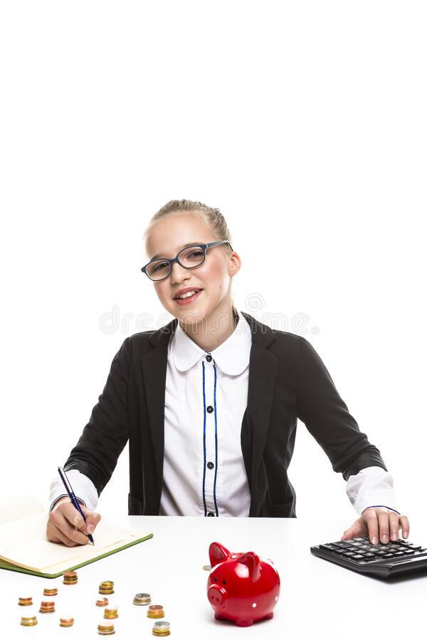 Children Frugal Concepts. Portrait of Happy Blond Teenage Girl With Coins and Moneybox. Calculating Money With Calculator For. Savings. Vertical image stock image