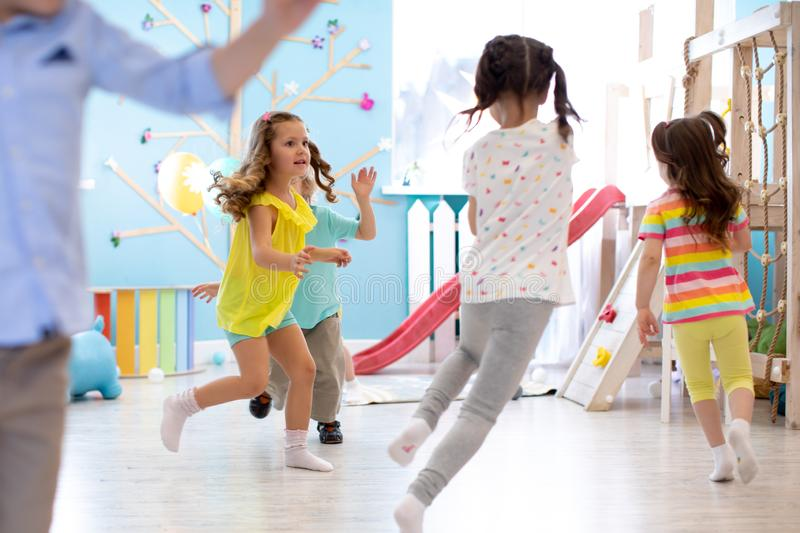 Children games in playroom. Kids play and run. stock photography