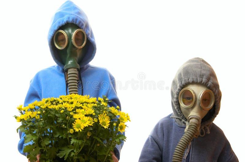 Children in gas masks stock image
