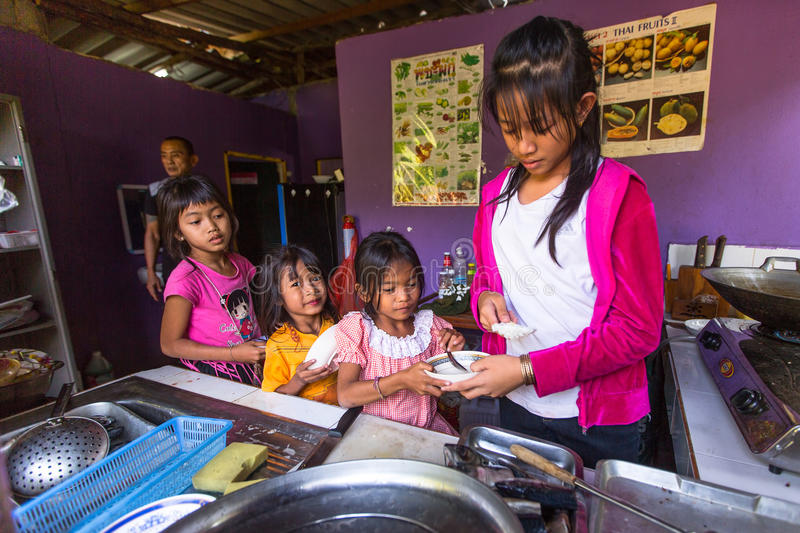 Children get food at lunch time at school by project Cambodian Kids Care royalty free stock photo