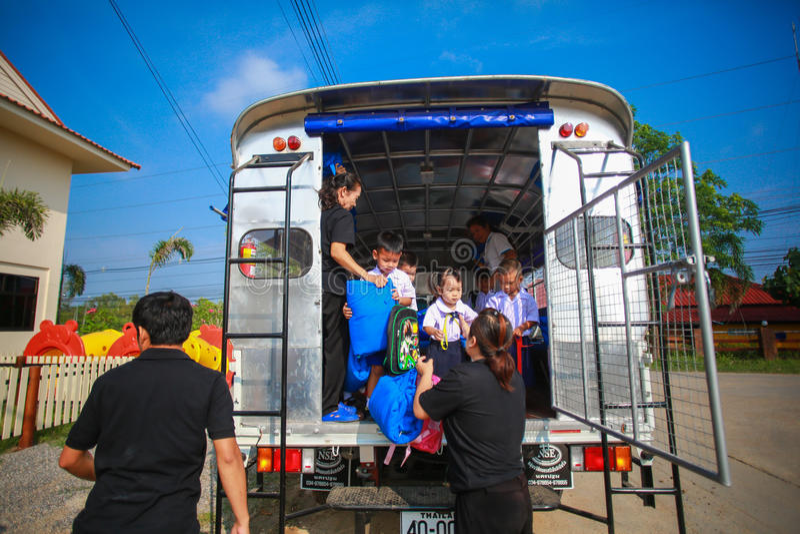 Children Getting off School Bus by teacher stock photos