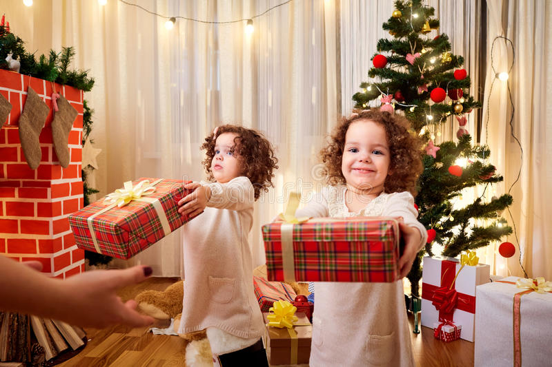 Children with gifts at Christmas. stock images