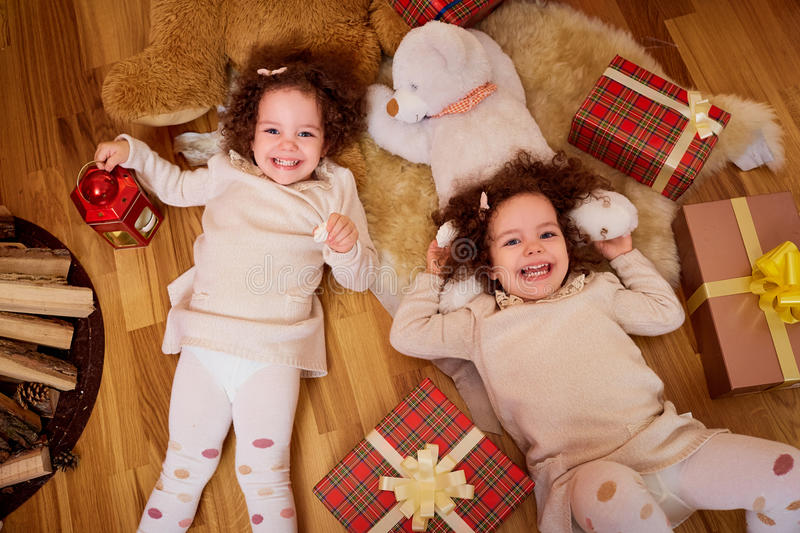 Children with gifts at Christmas. View from above. Two little gi royalty free stock photo