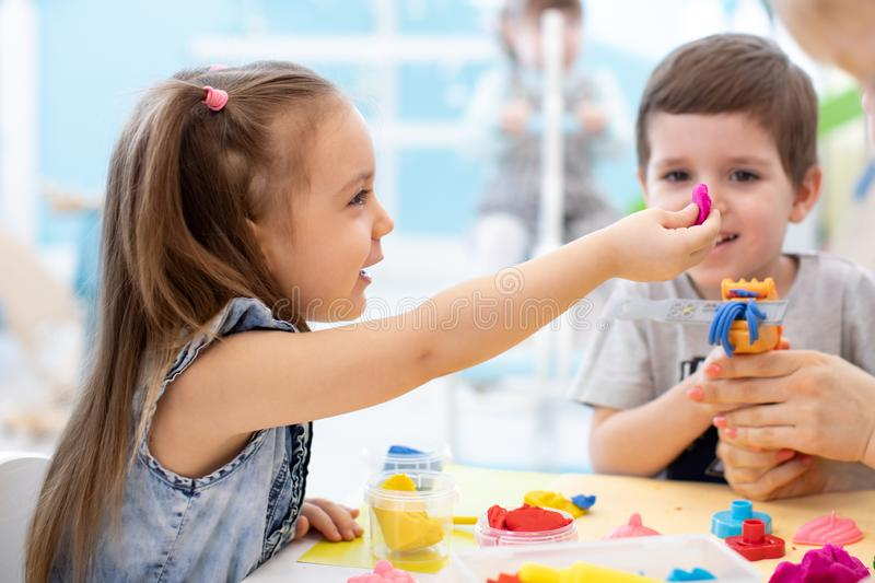 Children girl and boy play in kids daycare center royalty free stock image