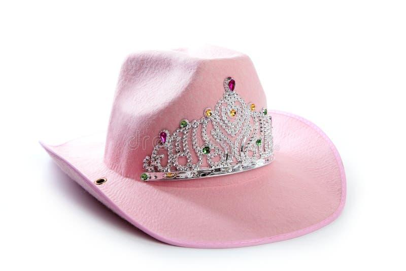 Children girl pink cowgirl crown hat. Children girl pink cowboy cowgirl hat with princess crown stock photo
