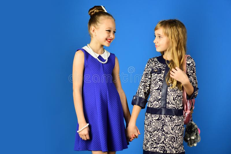 Children girls in dress, family and sisters. Friendship, look, hairdresser, wedding. Family fashion model sisters royalty free stock photography