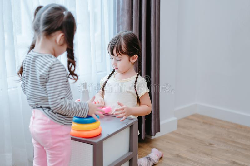 Children girls play a toy games in the room stock photography
