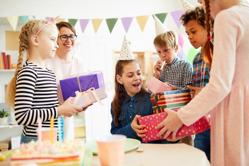 Children giving Birthday Presents royalty free stock images