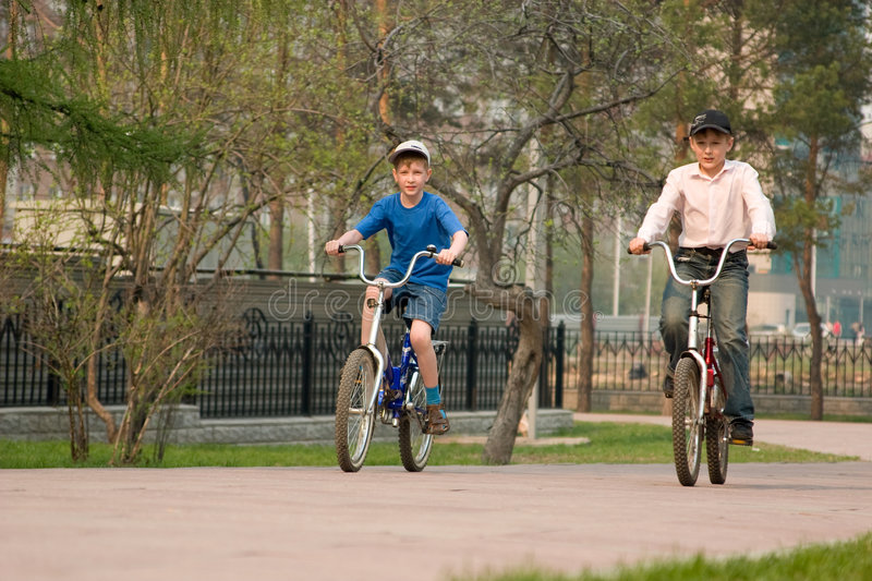 Download Children Go For A Drive On Bicycles On Park. Stock Photo - Image: 5212236