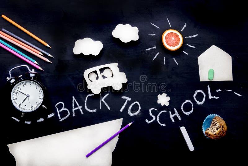Children go to school on a school bus Children`s creativity. Application on a blackboard. Pencils, scissors and alarm stock images
