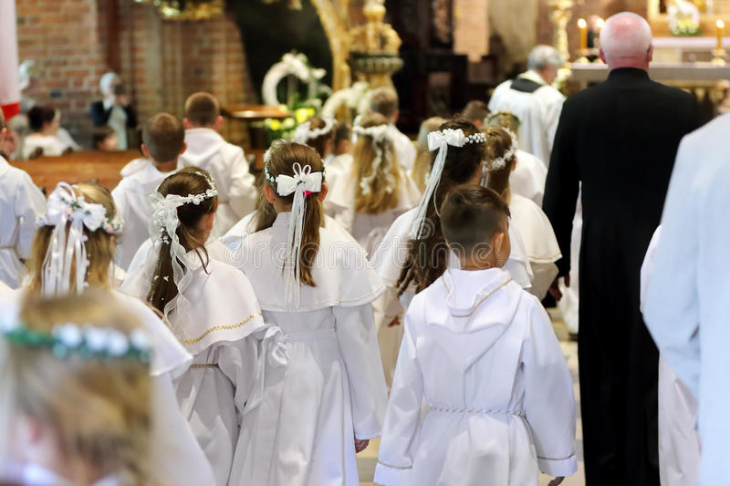 Children going to the first holy communion stock photos