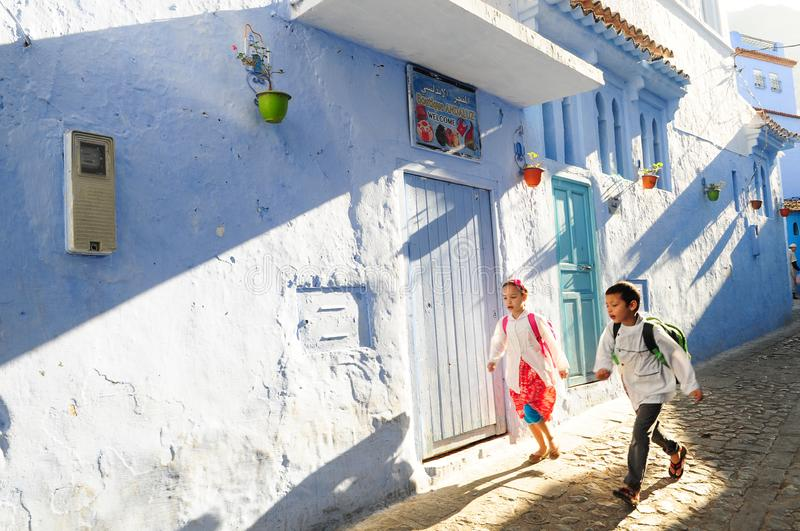 Children going to school in a hurry in the early morning stock photos