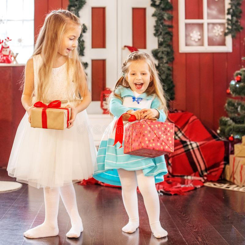 The children got the gift boxes. Concept New Year, Merry Christ. Mas, holiday, vacation, winter, childhood stock image