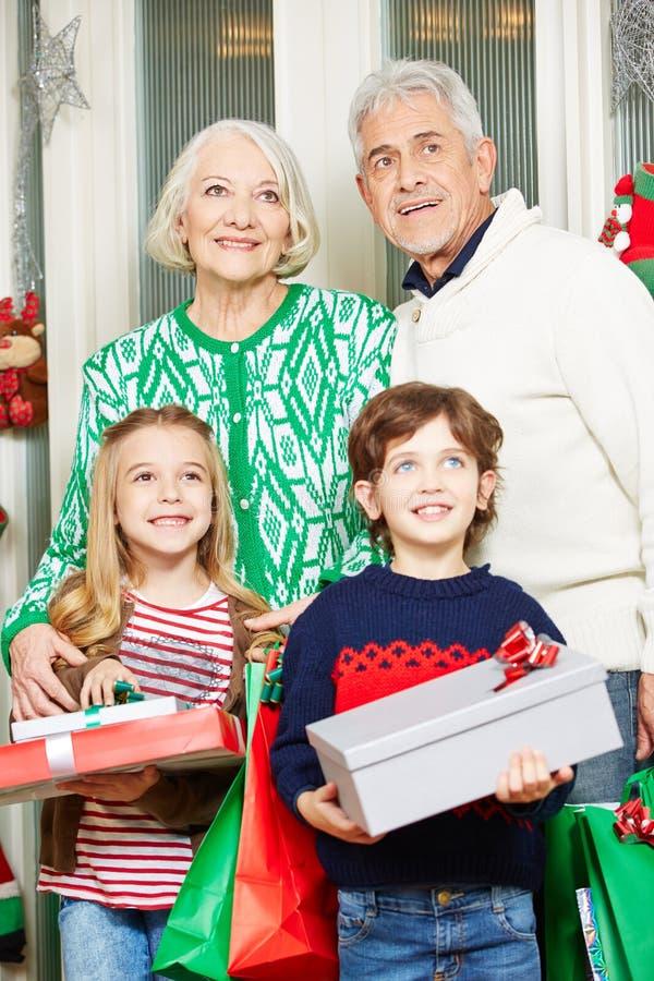 Children with grandma and grandpa stock photo