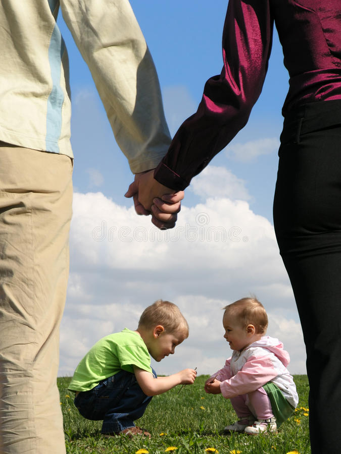 Download Children On Grass And Parents Holding Hands Stock Photo - Image: 12540244