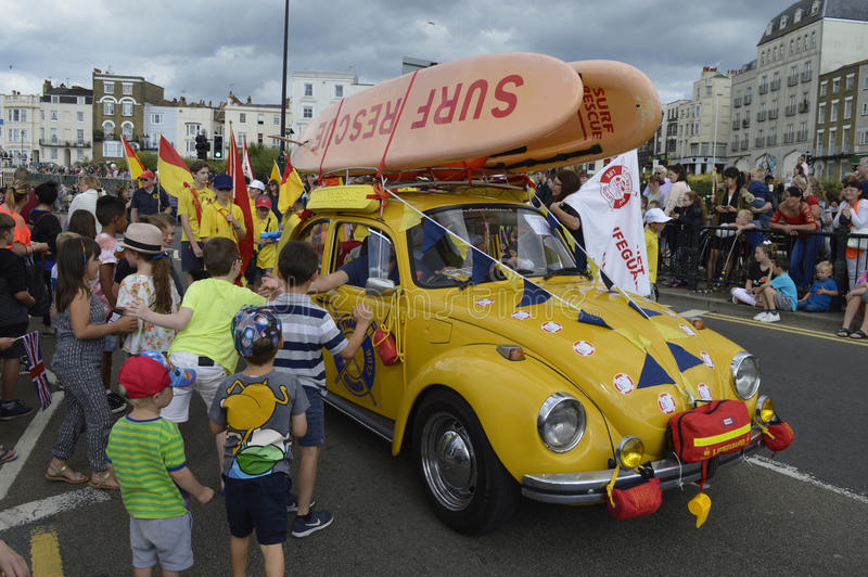 Children greet the lifeguards in the Margate Carnival royalty free stock photo
