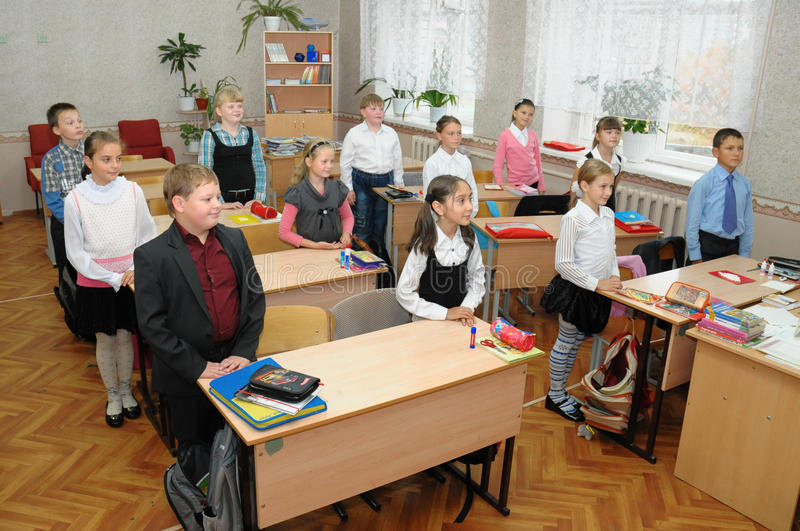 Children greet the teacher before the lesson begins. Gajievo, Russia - September 09, 2010: Children greet the teacher before the lesson begins stock photography