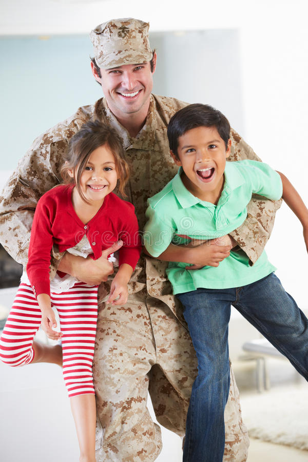 Children Greeting Military Father Home On Leave royalty free stock image